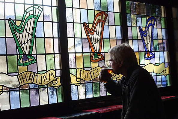 Man drinking glass of beer