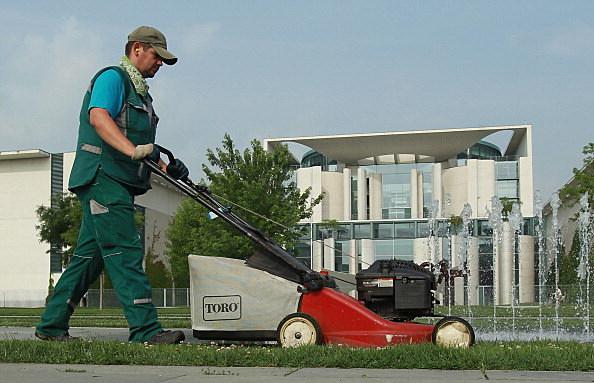 man pushing lawnmower