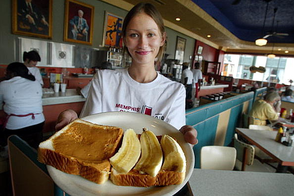 Waitress holding a platter with peanut butter and banana sandwich