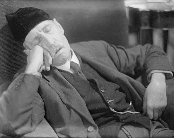 man sleeping on chair