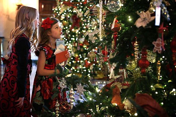 Girls looking at Christmas tree