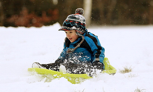 child on sled in winter