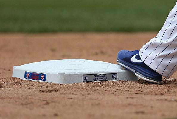 Foot on baseball bag