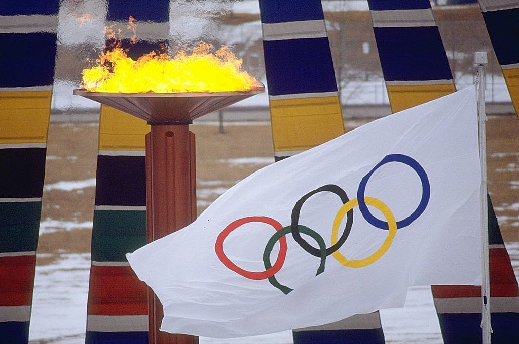 General view of the Olympic flag and flame at the 1988 Winter Olympic Games